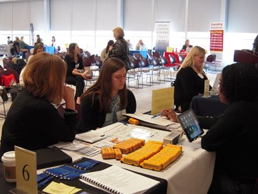 Students participating in the teacher job fair.