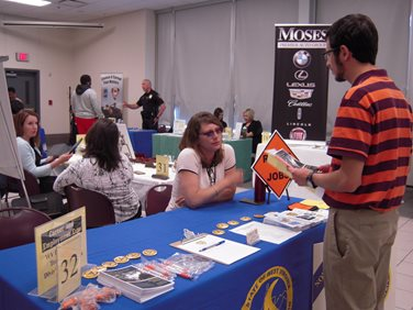 A student talking with a recruiter at the career expo.