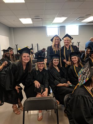Smiling social work students on graduation day.